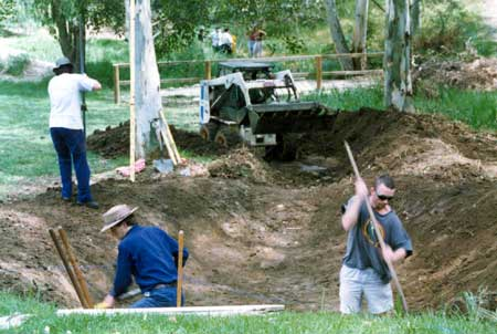 Drainage ditch excavated with workers